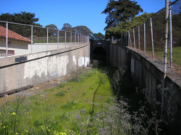 In 2009, the Fort Mason tunnel is closed and grass covers the lines
